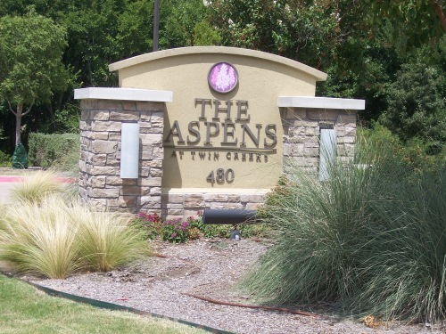 This sign located at 480 Bray Central Drive in Allen, Texas 75013 next to the driveway identifies The Aspens at Twin Creeks. This is an active adult community.
