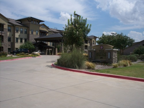 A covered driveway provides a convenient entry to The Aspens main building during all weather conditions. Parking places are on one side of the circular driveway. Residents have parking places inside the gated area.